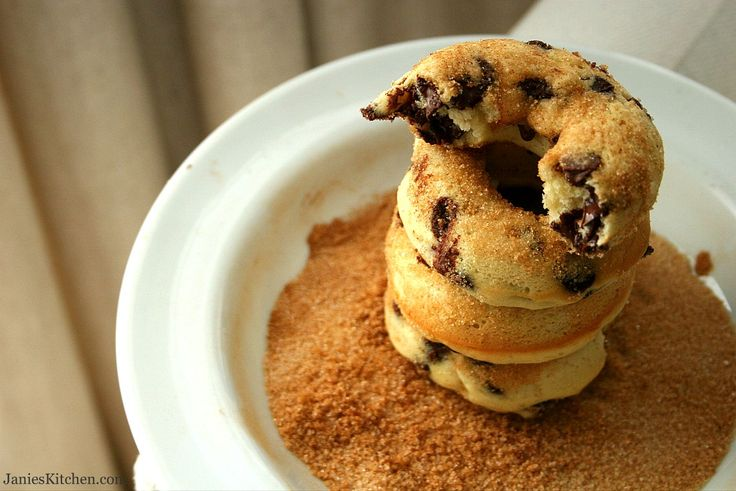 Banana Chocolate Chip Baked Doughnuts - perfect healthy snack for any age.  The Greek yogurt and spelt flour make this typical naughty sweet treat healthier than you would imagine.