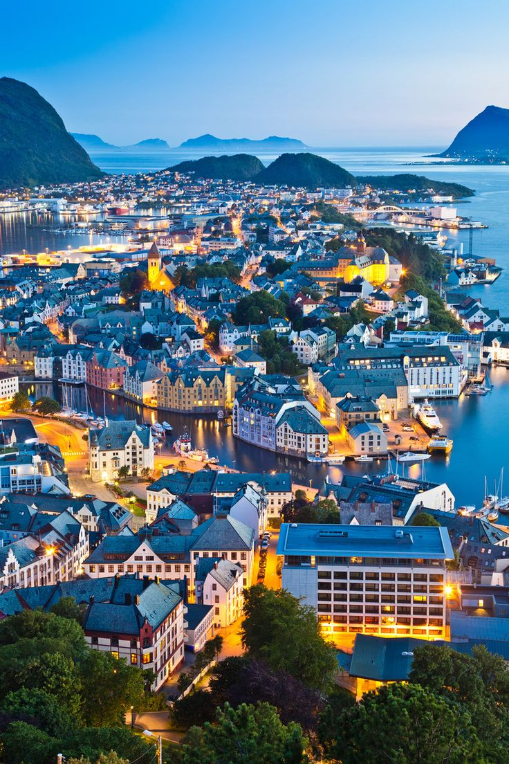 Alesund, Norway. Art Nouveau is the signature architectural style of this village of small islands and canals. A charming harbor, towering fjords and mountains complete the picturesque setting, especially at twilight.