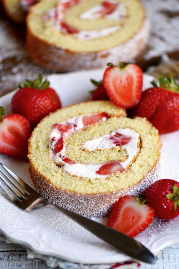 This Strawberry Shortcake Roulade is the perfect summer dessert. Cake rolls are always stunning but this one is particularly so. Light and airy cake wrapped around a sweet whipped cream and fresh strawberry filling. Irresistible! // Mom On Timeout