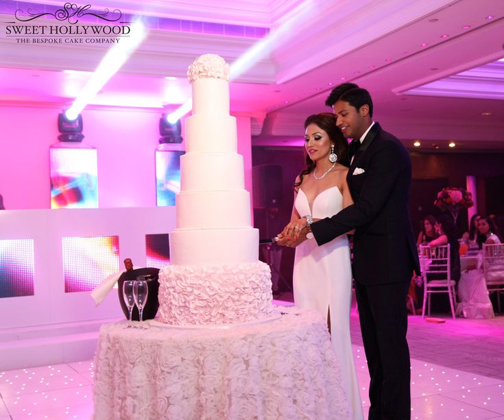 Bride Groom Cut Into Their Pretty In Pink Luxury Wedding Cake By Sweet Hollywood InterContinental London Pa