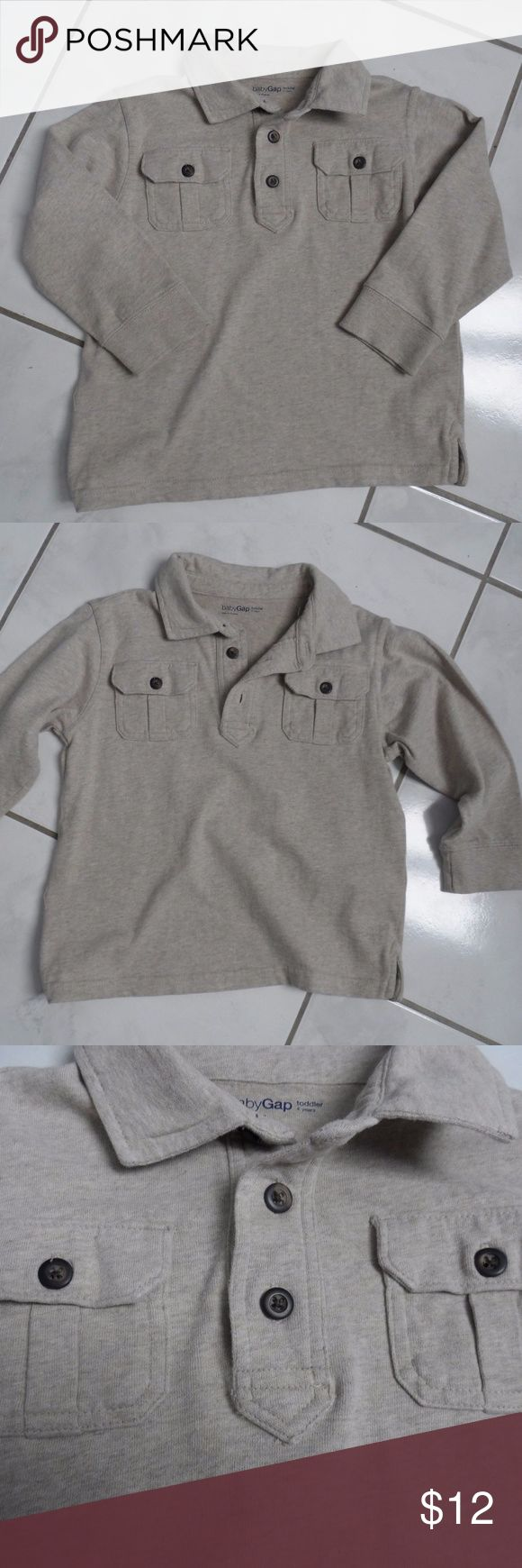 Baby Gap Polo Oatmeal Long Sleeve Shirt Boys 4T Great long sleeve polo shirt from baby Gap in size 4 years or 4T. Heathered tan beige oatmeal color. Three button closure at neck. Two working button pockets on front. Super soft, 100% Cotton. Always washed on delicate and hung to air dry. GAP Shirts & Tops Polos