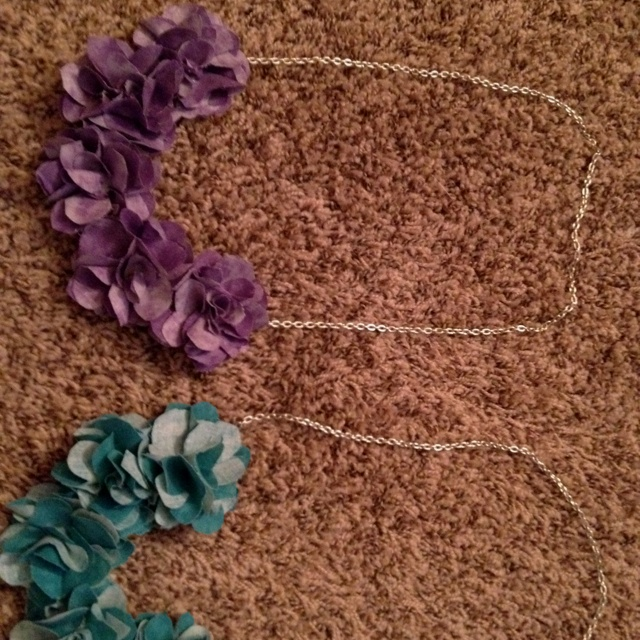 Mini flowers made from cotton. Glued to felt and necklace then added.