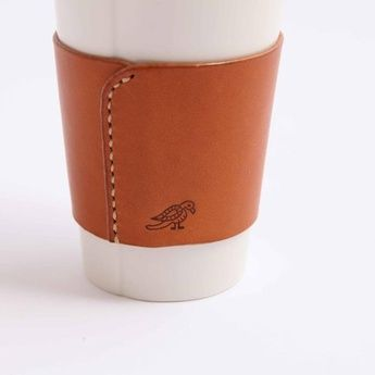 Leather cup cosy.  This is vaguely ridiculous.  One Kiln.
