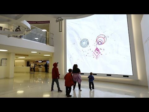 UConn researchers designed an interactive media wall for the lobby of Boston Children's Hospital. It is a place where physically and emotionally challenged c...