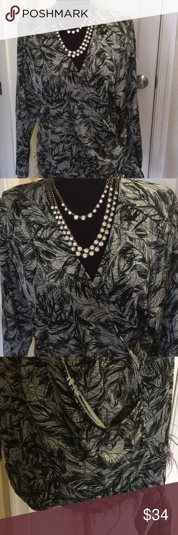 """COLDWATER CREEK HOLIDAY GLAM TOP SILVER BLACK 2X DEEP V neckline long sleeved silky stretchy silver & black design, diagonal wrap look w/ tie at bottom. BLend of acetate, Nylon & Spandex for perfect feel & fit. Size 2X....26 - 30"""" pit- pit...25"""" shoulder - edge, great w black silver Cami underneath if your shy... MINT 🎀❄️🎀❄️🎀 Coldwater Creek Tops"""