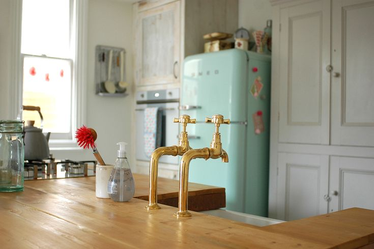 kitchen renovation tour — Patchwork Harmony. Kitchen makeover - brass bib taps, mint green Smeg fridge and freestanding vintage larder.