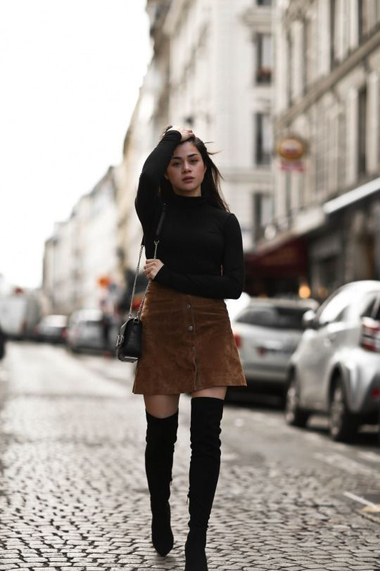 Brown Button Front Skirt paired with over-the-knee boots and black long sleeve shirt