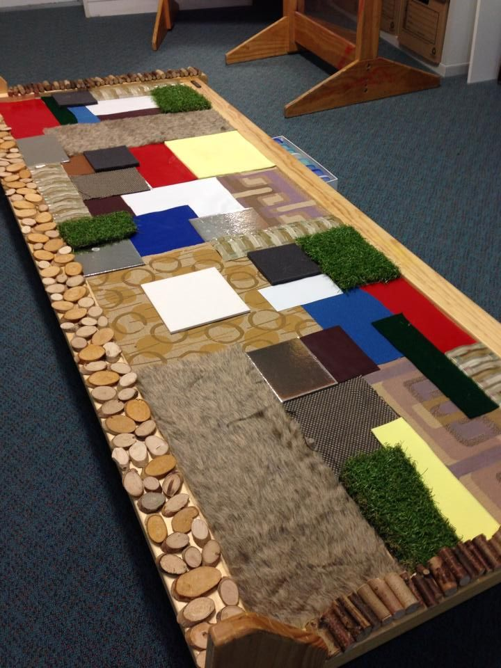 Sensory mosaic playspace... length for a number of kids to interact with their own figures