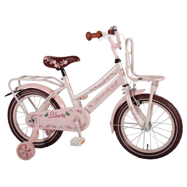 """Volare Kinderfiets Liberty Urban 16"""" roze Roze  Description: De Volare Liberty Urban 16 inch roze met bruine kleuraccenten is een mooie transportfiets voor meisjes in de leeftijdsklasse van 4 tot 6 jaar. De Liberty Urban heeft een stalen oversized frame en zorgt dat de fiets stevig is en tegen een stootje kan. De terugtraprem in het achterwiel en de knijprem op het voorwiel zorgen ervoor dat je kind veilig kan remmen en tot stilstand kan komen. De zijwieltjes zorgen voor ondersteuning en kan…"""