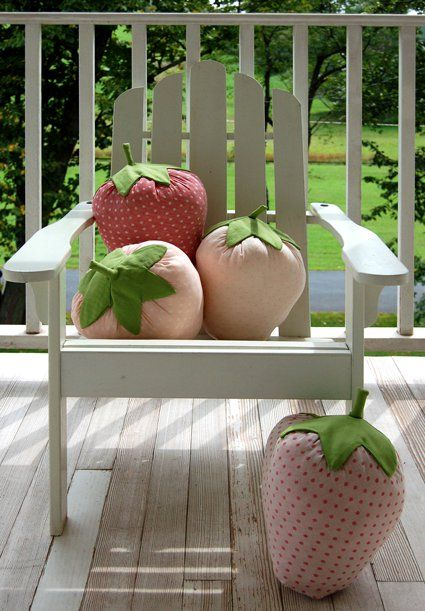 DIY Strawberry Pillows!  These pillows are easy and quick to make, a perfect end of summer project! The  best thing about them is seeing other people's reactions to them.  Everyone who sees them wants to touch them, squeeze them, and carry them  around. There is something about their large size (about 15-inches  high) that just makes people smile!  --Molly