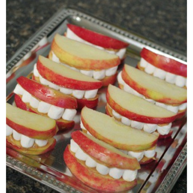 Apples, peanut butter, marshmallow Halloween snack for kids. Maybe pumpkin cream cheese instead of PB for preschool snack?