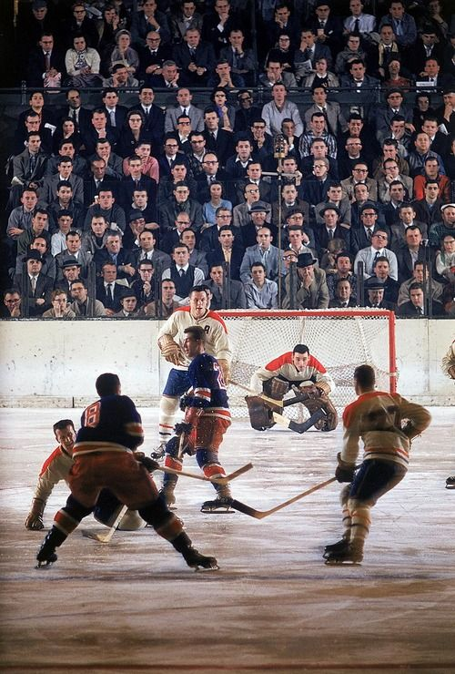 Montreal Canadiens vs. New York Rangers at Madison Square Garden, December 12, 1957. Note the lack of helmets, face-guards, and minimal protection for the crowd.
