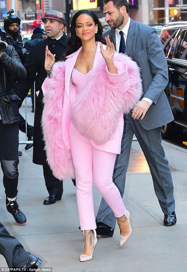 Rihanna in a pink Pascal Millet pantsuit - so dope!