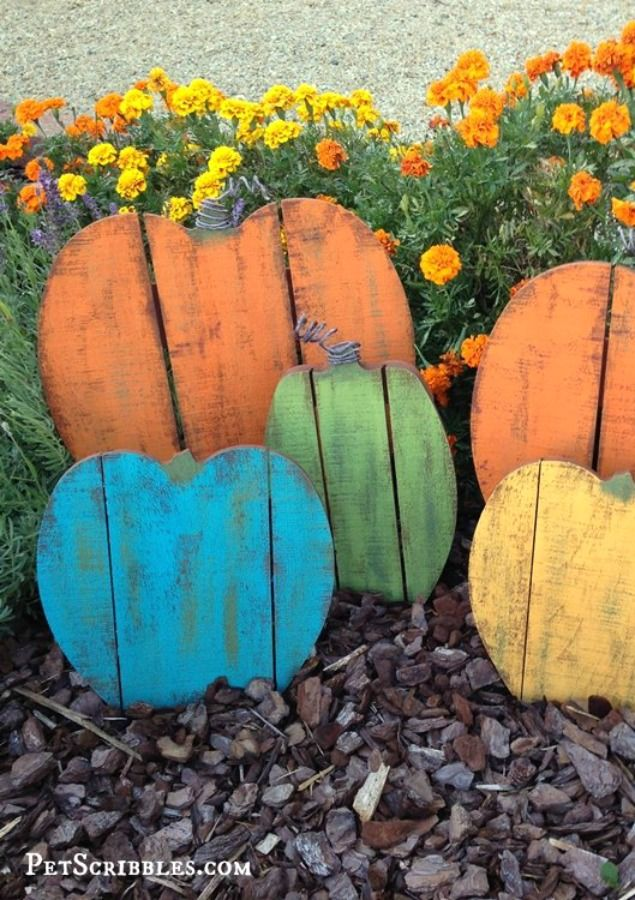 Go for a more rustic vibe in the garden with a colorful mix of pumpkins made from pallets. After all, who said pumpkins always have to be orange? Get the tutorial at Pet Scrabbles.    - Redbook.com
