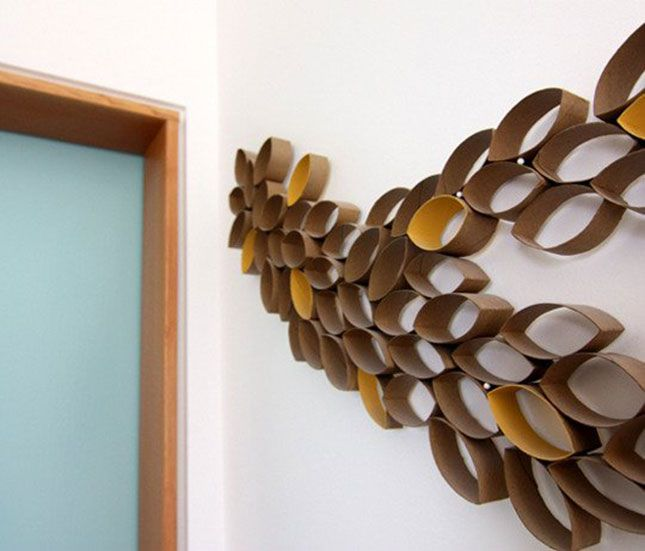 Want to know a secret? This wall art was made from toilet paper rolls!