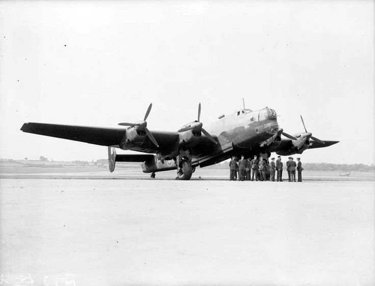 Halifax Mark I Series 1, L9503 'TL-P', of No. 35 Squadron RAF based at Linton-on-Ouse, Yorkshire, ready for inspection at Northolt, Middlesex, during a visit by the Prime Minister. L9503 flew on many of 35 Squadron's early operations before it was lost attacking Hamburg on the night of 15/16 September 1941.