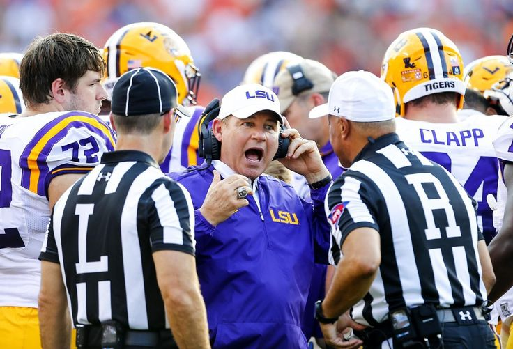 Les Miles has finally been done in by one of the frantic finishes that came to define the Mad Hatter's tenure at LSU.  LSU fired Miles and offensive coordinator Cam Cameron on Sunday, and promoted defensive line coach Ed Orgeron to interim head coach.  The moves came less than 24 hours after Miles