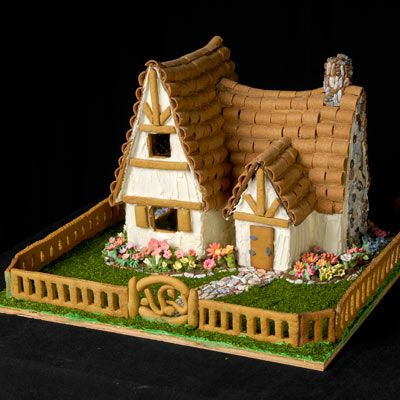 The majority of this display's details are made of brown fondant and white royal icing. The decorative flowers are made from gumpaste, which can be sculpted like clay before it hardens to a porcelain-like state. | Photo: Wright Creative | thisoldhouse.com