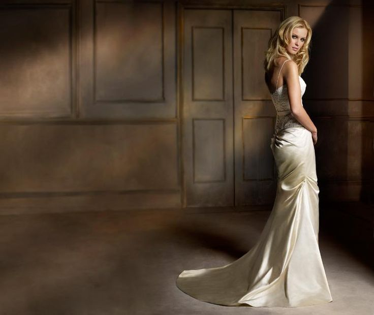 Acapulco & Brazil  A bridal fantasy. Chic corded lace camisole with duchess satin skirt, asymmetrically draped pleats and puddle train.