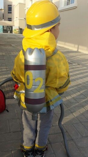 Oxygen tank for firefighter costume made from an empty pop bottle spray painted