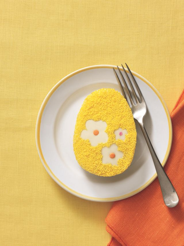 Use a cookie cutter to form the egg shape of this rich dessert with lemon cream-cheese frosting.