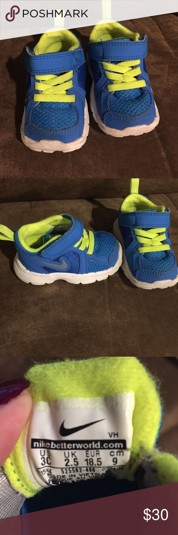 Baby nikes Euc only worn once, son outgrew too fast. Price is FIRM! Bright blue and neon green Nike Shoes Baby & Walker