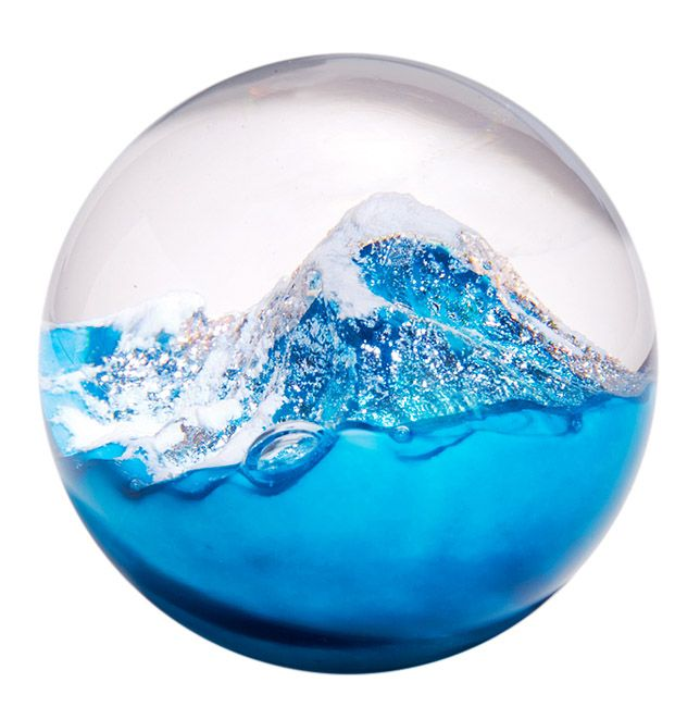 Glacier Paperweight Glass Paperweight Handcrafted by Glass Eye Studio As they cut through mountain ranges, glaciers carve away valleys, leave large lakes in their wake, and create large sandy beaches where they slowly drop into the ocean. All glass produced by this studio contains ash from the 1980 Mt. St. Helens eruption. Handcrafted by Glass Eye Studio in Washington. Dimensions: 3 inches in diameter.