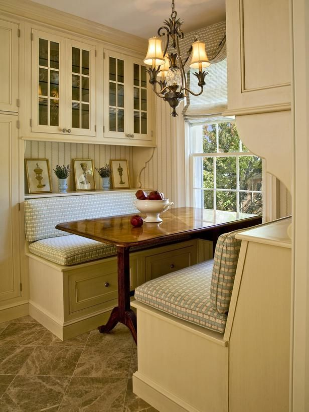 Love the cozy feeling, but drawers under a table makes no sense. A better design would be to have a piano hinge bench seat for easy access to storage.