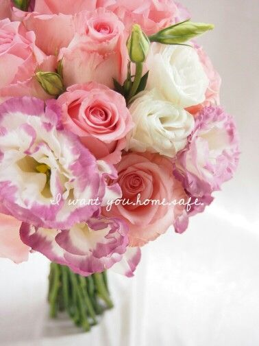 Hand-tide hand bouquet of pink roses and eustomas.