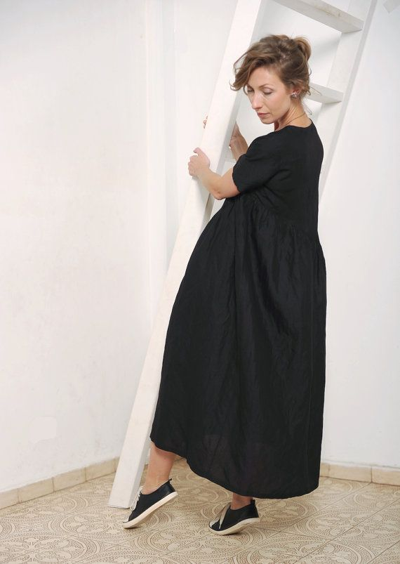 For this dress I used linen fabric. It is black and has very delicate almost unnoticeable silver shiny effect. The dress has round neckline and gathered diagonal skirt.