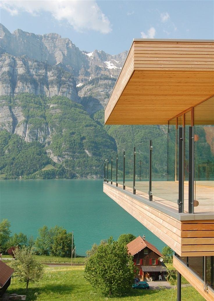 Single family home designed by k_m Architektur located in Unterterzen, Switzerland, with a clear view of lake Walensse and the mountains of Churfirsten