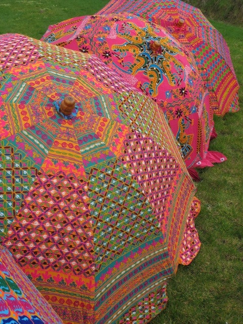 vintage sari garden umbrella. i would love to own one of these. i use parasols sometimes walking instances in the sun. ( just like the other island women )