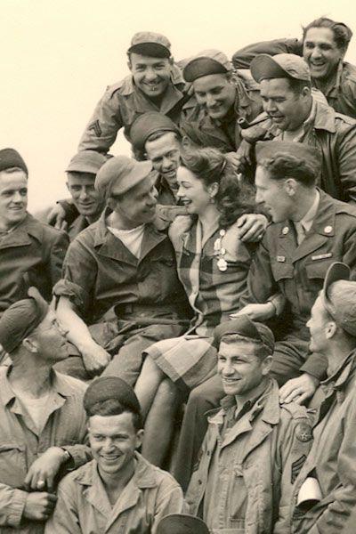 World War II Pin-up girl Margie Stewart visiting troops in Reims, France in June 1945