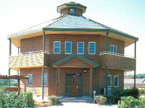 The carpentry way a modern example of an octagon house in for Modern octagon house plans