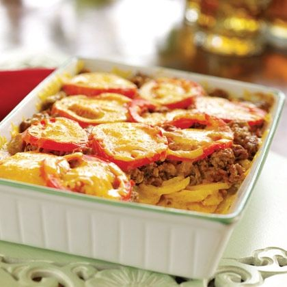 Bacon Cheeseburger Bake. This classic casserole dish is easily made with ground beef, potatoes, cheddar cheese and tomatoes.