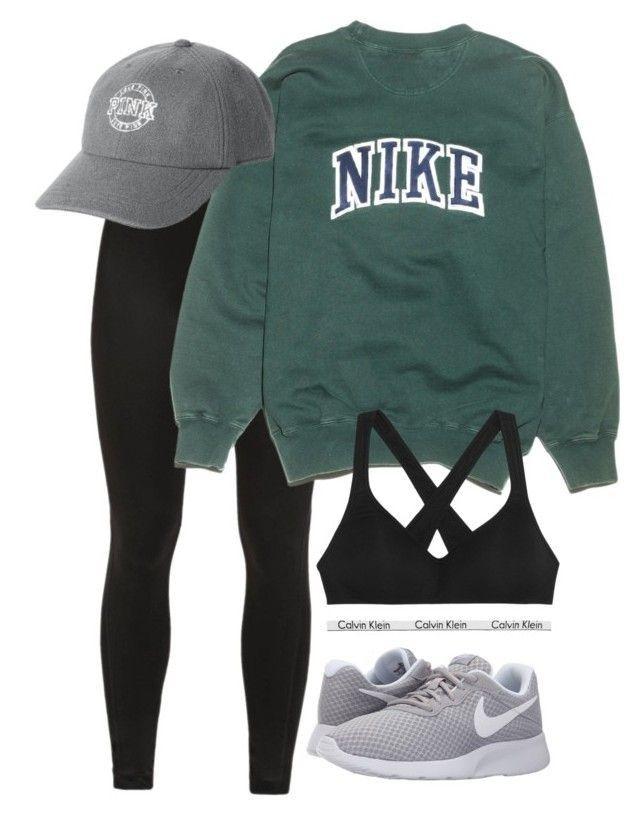 Wear sports bra, Wolfpack sweater, black leggings, sneakers, baseball cap.