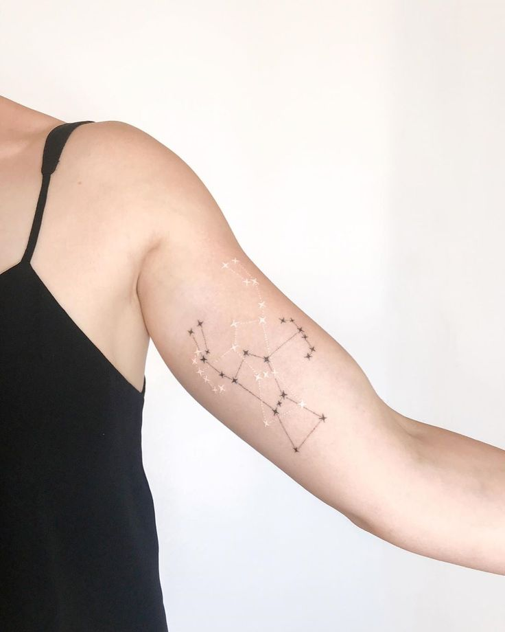 Black and white Orion constellation tattoo by Ann Gilberg inked on the left bice…