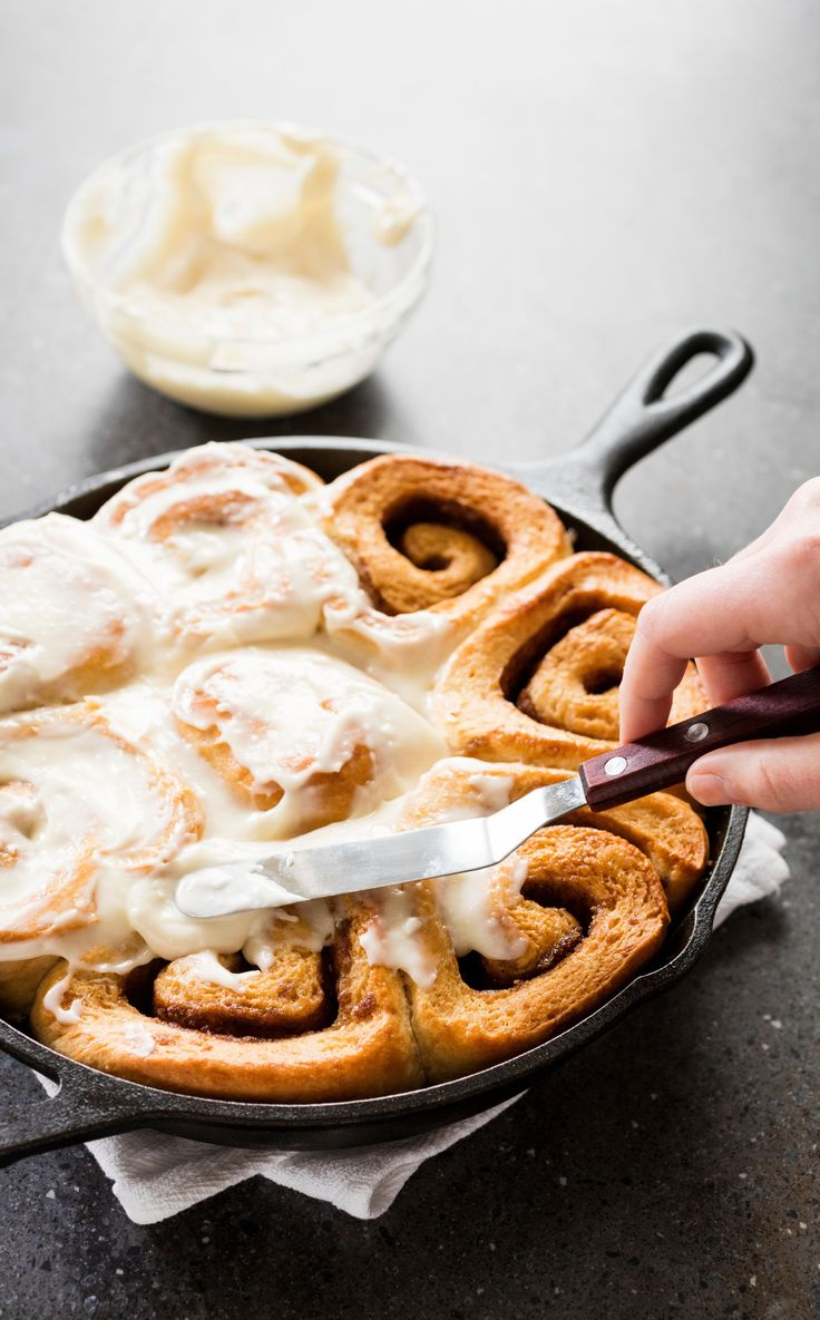 Cast Iron Cinnamon Rolls. Fluffy, golden-brown cinnamon buns with sweet filling and gooey icing are the ultimate treat, but between mixing, kneading, rising, shaping, rising again, baking, and icing, they can take a whole lot of effort and time. We set out to simplify that.