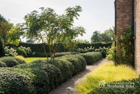 Aangelegde tuinen door tuinonderneming Monbaliu - Dubbel goud voor grandeur met speelse accenten