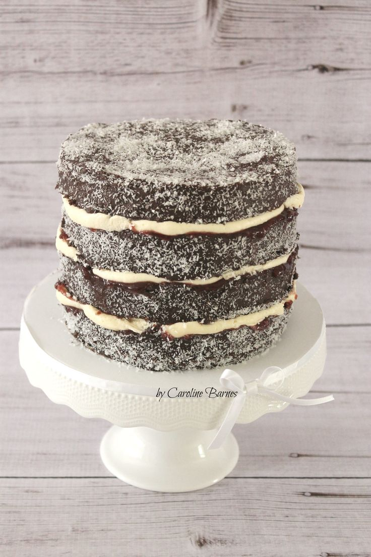 Lamington cake to celebrate Australia Day. Sponge cake coated in chocolate and coconut and filled with jam and cream.