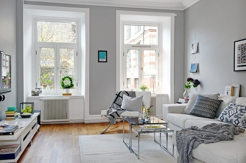 Light grey walls give a crisp, bright, feel to this living room.