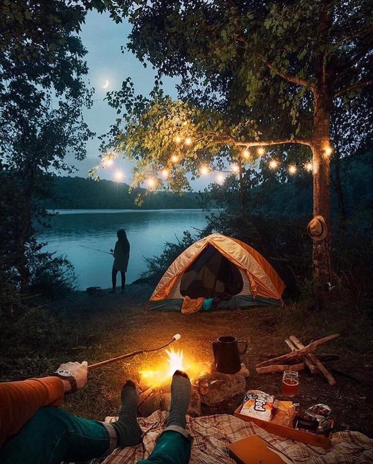 351e84d85f1e9 Camping in the woods. roasting s'mores by the fire. tent by the lake ...