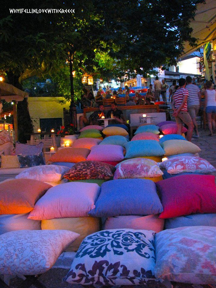 """Colorful cushions on the cobbled street leading up to the old town and overlooking the sea ~ """"Rock'n'Roll"""" Bar in Skiathos"""
