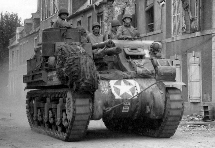 105mm Motorized Howitzer M7 Priest with the 14th Armored Field Artillery Battalion of the 2nd Armored Division moves along the Rue Holgate, Carentan, France. 18 June 1944.