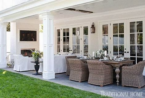 At Home with Bill and Giuliana Rancic. Furniture from Restoration Hardware. The long covered patio is divided into a dining area and a sitting area. | Traditional Home. http://www.consumeraffairs.com/homeowners/restoration.html