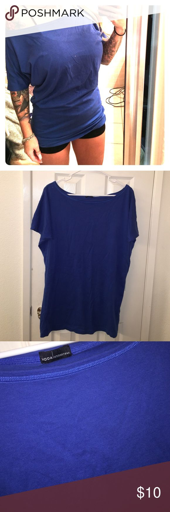 Off the shoulder tee Blue off the shoulder tee. The length is the same size for front & back.  I purchased this through Victoria Secrets online store. I also have in olive green (which is posted) 100% cotton.  The sleeves run tight. Moda International Tops