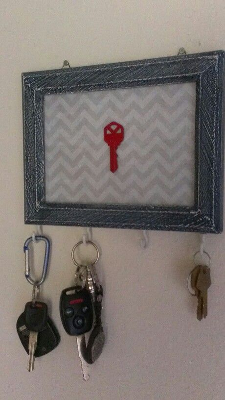 DIY #keyrack. Had most of the materials at home so it cost less than buying one and has more personal meaning.  Screwed hooks into a wooden frame, printed a pattern for the background and painted and attached our first house key together.