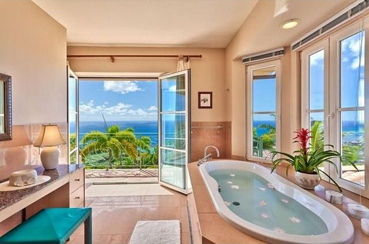 Beach House Bathroom - Tropical Master Bathroom with Glass door, French doors, Exira Roman Tub Faucet and Hand Shower, Flush, Drop-In Bathtub