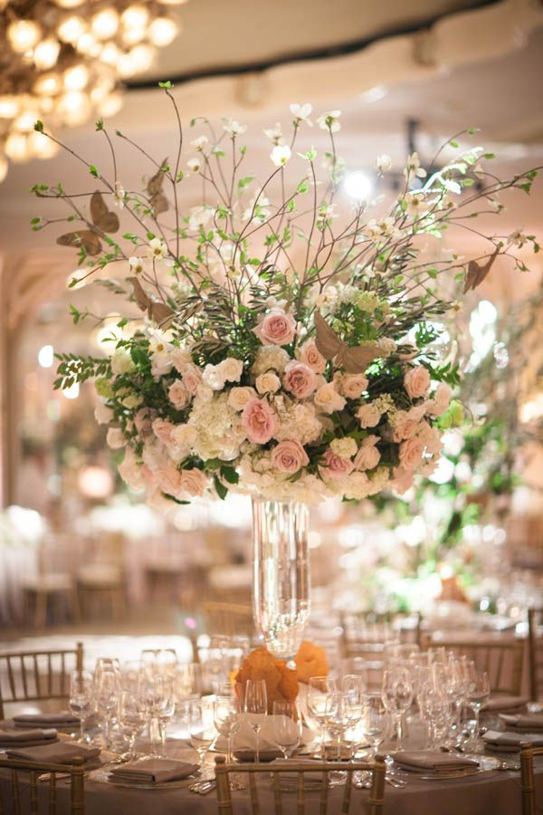 Romantic and timeless enchanted forest wedding reception centerpiece at The Beverly Hills Hotel in Los Angeles | luxury hotel wedding venues in Southern California (Miki and Sonja Photography)