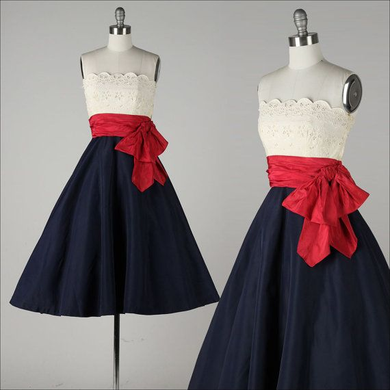 ➳ vintage 1950s dress    * white eyelet cotton  * red silk shirred waist/bow  * navy blue taffeta skirt  * acetate lined bodice  * boning in